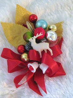 Vintage Christmas Corsage w Reindeer. I am probably dating myself greatly....but I SO remember getting these as a girl. We'd pin them to our coats so that they wouldn't get crushed!!!