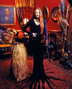 Gillian Anderson as Morticia Addams. Epic Halloween Awesomeness ♥ holy shit this is super hot!