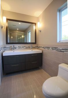 Contemporary Master Bathroom with Corian counters, Cylinder Glass Bath Sconce…