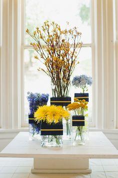 Navy & Yellow Floral Display I like the navy and yellow ribbon idea