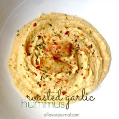 A simple dip for summertime!  Keep your calories low and the flavors high: roasted garlic hummus is easy to make and is so yummy! | a flavor journal.