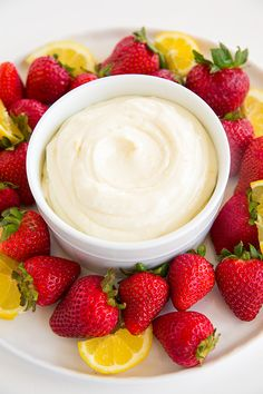 Lemon Cream Fruit Dip - only requires 4 ingredients and a few minutes to make! I was eating it by the spoonful! AMAZING!!
