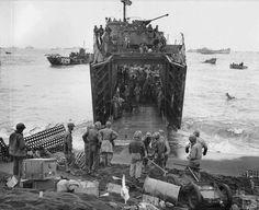 US Marines unloading supplies from a LSM Iwo Jima Japan 22 February 1945.