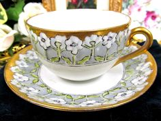 GERMAN TEA CUP AND SAUCER PAINTED PRETTY FLORAL TEACUP PATTERN