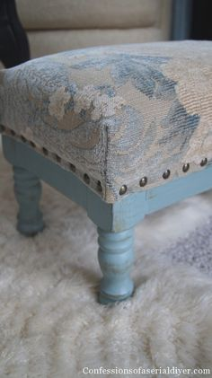 Reupholstered stool with semi-permanent slip cover