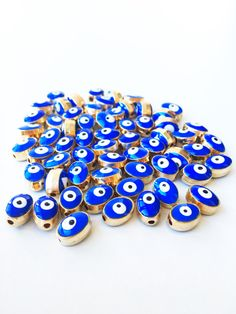 A personal favourite from my Etsy shop https://www.etsy.com/listing/462286908/5pcs-oval-evil-eye-spacer-beads-6mm-evil