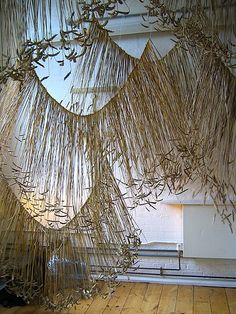 Rowan Mersh hanging installation composed of wheat, barley and oats   strung onto mono-filament wire