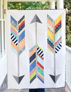 Forget old lady quilting stereotypes. Nowadays, these blankets are all kinds of hip, quirky, and modern — ideal for snuggling or decorating a wall.