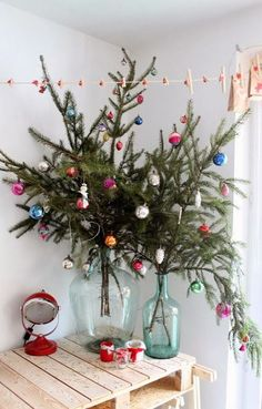 A twist on traditional. These decorated branches in vases are a great way to save space and still create a festive vibe.