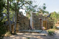 """""""We really wanted to capture the ruinous quality of this old building rather than do something overtly new,"""" Blee says. Before construction could begin, however, he and Halligan had to patch the remaining walls using stones found in the nearby river. Wherever a wall had collapsed, the designers inserted framing to create windows and doors. For the roof, they turned to the original tiles. """"My father's terrible at throwing things away,"""" Blee says. """"We took the tiles off 30 years ago, as it…"""