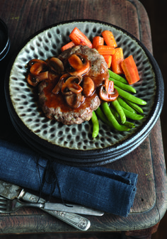 "Country Salisbury Steak – Stuffing mix is the secret in this Healthy Living version of a dinertime classic. Topped with mushroom sauce and served alongside green beans, this easy-to make oven dish makes the perfect savory ""special"" at your house!"