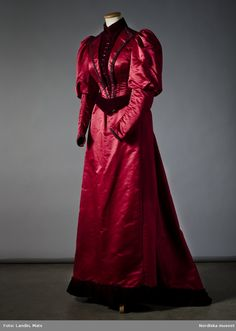 Dress of burgundy atlas silk. Made in Augusta Lundin, Stockholm. 1890s
