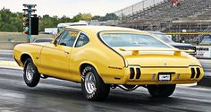 1970 Olds Ralleye 350 post-coupe, launching off the line. Hurst Oldsmobile, Oldsmobile Cutlass, Drag Cars, Gto, Drag Racing, Hot Cars, Buick, Motor Car, Muscle Cars
