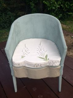 """Bedroom chair painted in Annie Sloan Duck egg, 2"""" foam cushion covered with a Lily of the Valley print linen. Front of chair and cushion have a scalloped edge. Front edge covered with a taupe leather  £38.00"""
