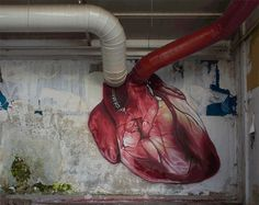 "Anatomically-correct heart using the building's piping as arteries / freehand spray paint / by LONAC ~ Zagreb, Croatia-born graffiti and street artist known for his photo realistic murals painted with spray cans and sometime brushesUsing a stepped approach in the progress of the painting, plus stop-motion video of each step, LONAC created the ""beating heart"" Gif"