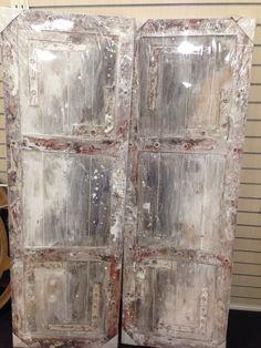 Art pair. Looks like an old door or vintage panels
