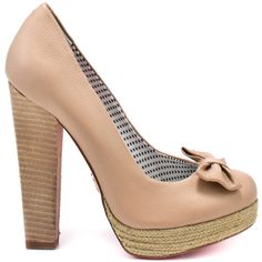 Sweet and summery can sum up this feminine style from Betsey Johnson.  Maggi has a nude leather upper complete with a 3/4 inch espadrille platform and 4 1/2 inch block heel.  Last but not least is a perfectly placed bow at the top of the vamp.
