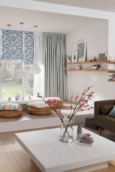 Natural wood and white make a perfect base for a zen like living room. Add pops of naturally bright colour in soft furnishings and cut flowers. Layer plain sheer and pattern fabrics to create a beautiful zen look in the home. Roman blinds, voile and curtains are perfect for this look.