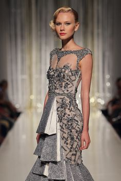 TONY WARD - Silver boat neckline evening dress with pearls and raffia embroidered on tulle and cascades of pleats in metallic raffia.