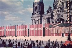 """Church and state: Swastikas and a maypole outside Berlin Cathedral in May Day 1937 - """"So long as they concern themselves with their religious problems the State does not concern itself with them. But so soon as they attempt by any means whatsoever- by letters, Encyclical, or otherwise- to arrogate to themselves rights which belong to the State alone we shall force them back into their proper spiritual, pastoral activity.""""Hitler, in Berlin on the May Day festival, 1937. (photo Thomas Neumann)"""