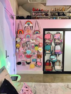 Smart with space: She had nowhere to store her fun novelty bags, so she put them on display on her wall