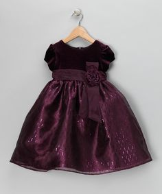 The classic A-line silhouette of this party-ready piece gives it timeless appeal while charming cap sleeves say this dress is ready for the fun to begin. It's topped off with a delightful bow accent at the waist for an extra splash of enchantment.Polyester / spandexMachine wash; tumble dryImported