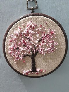 Pin by Simple Embroidery by Lorna on Silk Ribbon Embroidery Designs Embroidery hoop Cherry Blossoms, hand embroidered hand made one of a kind pink b.Hoop art Indian Jewellery machine embroidery linen with - Salvabranihow to make french knots embroideryhan French Knot Embroidery, Hand Embroidery Videos, Embroidery Stitches Tutorial, Embroidery Flowers Pattern, Learn Embroidery, Hand Embroidery Stitches, Silk Ribbon Embroidery, Embroidery Hoop Art, Hand Embroidery Designs