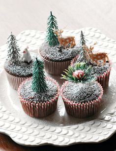 Snow-covered chocolate #cupcakes lightly dusted with powdered sugar. Take us to this winter wonderland! #recipe #food #holiday