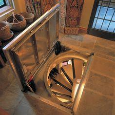 Very cool spiral under-floor wine cellar