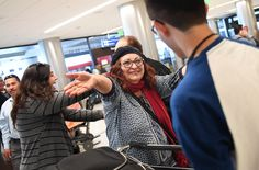 Alicia Gomez, 60, greets her son Mauricio, now 17, after he arrived at LAX from El Salvador.