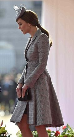 During much of the visit Kate kept her arms folded across her stomach clutching her bag in an instinctively protective gesture