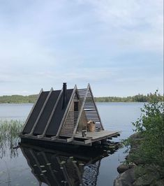 Could there possibly be a better spot to spend a summer afternoon? Imagine dipping your toes in the water and taking in the view while… Tyni House, Tiny House Cabin, A Frame Cabin, A Frame House, Pontoon Houseboat, Lake Floats, Shanty Boat, Cool Tree Houses, Floating House