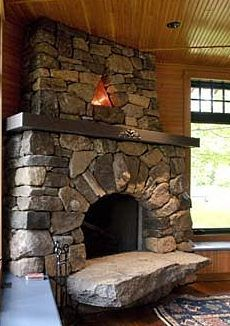 Nice. Note, however, the large stone bottom draws to much attention, taking away from the rest of fireplace. Toned down color would make this better.