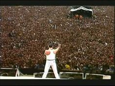 """""""The last people anyone expected to come out of that gig as being the memorable ones was Queen,"""" said Bob Geldof in an interview. Watch Queen's Stunning Live Aid Performance: 20 Minutes Guaranteed to Give You Goose Bumps (July 80s Music, Music Songs, Music Videos, Sound Of Music, Good Music, Queen Videos, Bob Geldof, Live Aid, Concert Stage"""