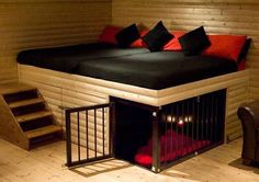 This awesome raised bed and underneath doggy crate amazing
