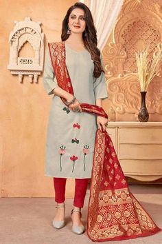 Exhibiting elegant embroidery and stitch detailing, this light beige cotton trouser suit which features beautiful embroidery work. This sweetheart neckline and 3/4th sleeve outfit accentuated with thread work. Presented with cotton cigarette pants in red color and red banarasi silk dupatta. Cigarette pant is plain. #trousersuit #salwarkameez #malaysia #Indianwear #Indiandresses #andaazfashion