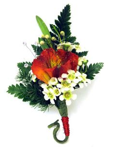 A beautiful orange and white boutonniere. Order your prom perfect design at The Flower Shop at Stauffers of Kissel Hill. http://www.skh.com
