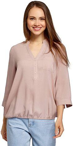 Tolle Bluse  Elegante gerade geschnittene Bluse mit V-Ausschnitt, der in kurze Knopfleiste übergeht. Die ¾-Ärmel mit knöpfbaren Manschetten lassen sich lässig krempeln. Der Saum ist gerafft. Eine kleine Brusttasche verleiht dem Modell eine Prise Einzigartigkeit. Weiche Viskose fühlt sich angenehm an, ist sanft, seidig und atmungsaktiv. Diese schöne Viskose-Bluse ist eine tolle Ergänzung Ihrer Garderobe. Tragen Sie sie zu einem Spaziergang oder einem Treffen im Freundeskreis. In dieser Bluse… Elegant, Tunic Tops, Long Sleeve, Sleeves, Fashion, Blouse Sewing Pattern, Cuffs, Cloakroom Basin, Scale Model