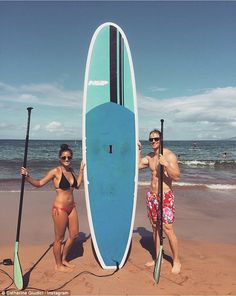 On island time: Posting a snap shot of them with their board on her Instagram, Catherine w...