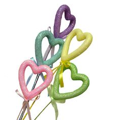 "Open Heart Picks Bundle of 5 Styrofoam hearts on a glittered stick Pink, Green, Blue, Lavender, Yellow Measures approximately 2 1/2"" in width on a 15"" stick, each heart has a matching ribbon  www.trendytree.com $2.99"