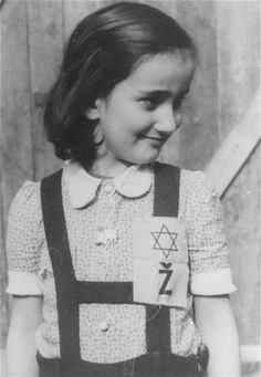 Portrait of a young girl in the Loborgrod concentration camp wearing a Jewish badge.