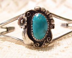 Shown here is a gorgeous sterling silver with blue oval turquoise cuff bracelet by the Canyon Silver Company. Called G. Slim. Beautiful detail