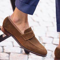 The penny loafer in snuff suede by @crockettandjones_official, an elegant choice for sunny days. #careofcarl #crocketandjones