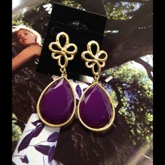 Purple Bohemian Style Earrings These goldtone earrings feature gold design on upper part and purple faux stones. Measure 2.2 inches long. Not heavy. (This closet does not trade or use PayPal) Jewelry Earrings