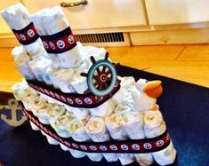 Items similar to 3 Tier Red Navy Nautical Diaper Cake, Red and Navy, Boy Baby Shower, Nautical, Sailboat, Anchor, Baby Shower, Baby Shower Centerpiece Decor on Etsy