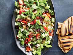 Greek chopped salad with grilled pita recipe - cooking light Pita Recipes, Greek Recipes, Healthy Recipes, Healthy Salads, Lunch Recipes, Diabetic Salads, Avocado Recipes, Yummy Recipes, Healthy Food