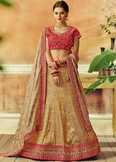 Beige And Gold Jacquard Silk Cord Work Wedding Wear Lehenga Get an eye catchy ethnic look to impress everyone in this beige and gold color wedding wear lehenga choli. Lehenga is crafted of jacquard silk and its choli is made of raw silk fabric. Heavy Lehenga, Lehenga Dupatta, Lehnga Dress, Silk Dupatta, Indian Wedding Lehenga, Bridal Lehenga, Raw Silk Fabric, Bollywood, Lehenga Choli Online
