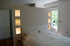 Make an enclosed alcove for the desk behind the bed?