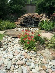 This is what I have in mind...starting with water feature at rock wall