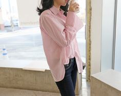 Light, comfy, and versatile - this pin stripe shirt packs a big punch in the style department.